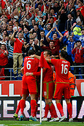 Wales fans jump up as Gareth Bale of Wales (Real Madrid) celebrates scoring a goal to make it 1-0 - Photo mandatory by-line: Rogan Thomson/JMP - 07966 386802 - 12/06/2015 - SPORT - FOOTBALL - Cardiff, Wales - Cardiff City Stadium - Wales v Belgium - EURO 2016 Qualifier.