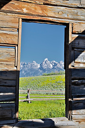 """Derelict log cabin, Teton View, Window, Grand Teton National Park, Jackson Hole, Wyoming<br /> <br /> For production prints or stock photos click the Purchase Print/License Photo Button in upper Right; for Fine Art """"Custom Prints"""" contact Daryl - 208-709-3250 or dh@greater-yellowstone.com"""