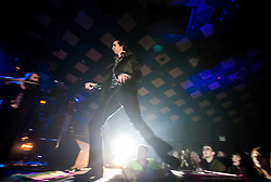 A wide angle shot of the frontman Nick Cave passing back onto the stage, Nick Cave and the Bad Seeds, on stage tonight at The Barrowlands, Glasgow, Scotland.<br /> ©Michael Schofield.
