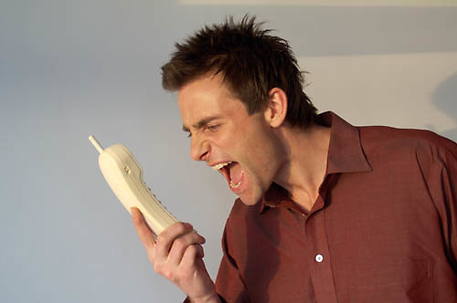 man shouting down the telephone<br />