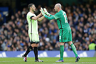 Martin Demichelis of Manchester City high fives Goalkeeper Wilfredo Caballero of Manchester City. The Emirates FA Cup, 5th round match, Chelsea v Manchester city at Stamford Bridge in London on Sunday 21st Feb 2016.<br /> pic by John Patrick Fletcher, Andrew Orchard sports photography.