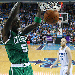 December 28, 2011; New Orleans, LA, USA; Boston Celtics power forward Kevin Garnett (5) dunks against the New Orleans Hornets during the third quarter of a game at the New Orleans Arena. The Hornets defeated the Celtics 97-78.  Mandatory Credit: Derick E. Hingle-US PRESSWIRE