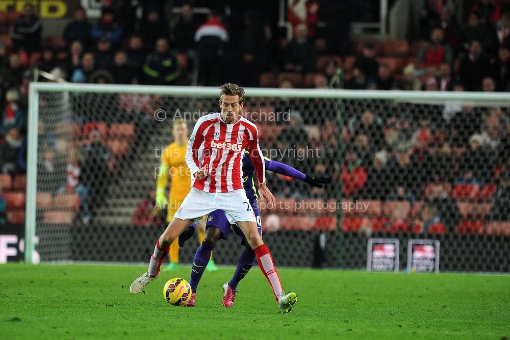 Peter Crouch of Stoke city in action. Barclays Premier League match, Stoke city v Manchester city at the Britannia Stadium in Stoke on Trent , Staffs on Wed 11th Feb 2015.<br /> pic by Andrew Orchard, Andrew Orchard sports photography.