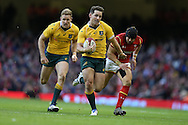Bernard Foley of Australia runs in to score a try in the 2nd half. Under Armour 2016 series international rugby, Wales v Australia at the Principality Stadium in Cardiff , South Wales on Saturday 5th November 2016. pic by Andrew Orchard, Andrew Orchard sports photography