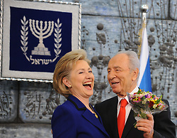 SHIMON PERES (2 August 1923 - 28 September 2016) was a Polish-born Israeli statesman. Born Szymon Perski, he was the ninth President of Israel from 2007 to 2014, served twice as the Prime Minister of Israel and twice as Interim Prime Minister, and he was a member of 12 cabinets in a political career spanning over 66 years. Peres won the 1994 Nobel Peace Prize together with Yitzhak Rabin and Yasser Arafat for the peace talks that he participated in as Israeli Foreign Minister, producing the Oslo Accords. PICTURED: Mar 3, 2009 - Jerusalem, Israel - Israeli President SHIMON PERES (R) presents flowers to visiting U.S. Secretary of State HILLARY CLINTON during a joint press conference. (Credit Image: © Xinhua/ZUMA Press)