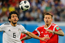 June 19, 2018 - Saint Petersburg, Russia - Fedor Smolov (R) of Russia national team and Ahmed Hegazy of Egypt national team vie for the ball during the 2018 FIFA World Cup Russia group A match between Russia and Egypt on June 19, 2018 at Saint Petersburg Stadium in Saint Petersburg, Russia. (Credit Image: © Mike Kireev/NurPhoto via ZUMA Press)