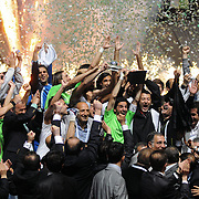 Konyaspor's players Omer HACISALIHOGLU (C) and coach Ziya DOĞAN (C) celebrate with the BankAsya Cup trophy during their Turkish soccer Play Off final match Altayspor between Konyaspor at Ataturk Olympic Stadium in Istanbul Turkey on Sunday, 23 May 2010. Photo by TURKPIX