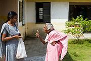 Lakshmi, an elderly resident scolds a social worker at Tamaraikulum Elders village, Tamil Nadu, India