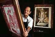 Artist Allen Saalburg with his serigraphs in his studio in Bucks County, PA