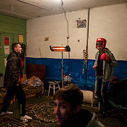 Young men at an improvised shelter in the basement of an apartment block in Donetsk.