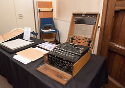 © Licensed to London News Pictures. 26/09/2016. Bristol, UK. Blue Plaque for Gordon Welchman; A WW2 German Enigma machine on display at the unveiling of the Blue Plaque by Gordon Welchman's daughter, Susanna Griffith with GCHQ Director Robert Hannigan and Bristol Deputy Lord Mayor Chris Davies, commemorating Gordon Welchman at St Mary's Church, Manor Road, Fishponds, Bristol. Gordon Welchman was born in Fishponds and was recruited to the Government Code and Cypher School (GC&CS) at Bletchley Park. He played an instrumental role in the development of Hut 6 and its famous code-breaking operations during WWII. Photo credit : Simon Chapman/LNP