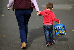 """File photo dated 13/10/15 of a child on the way to childcare. More than a million families will benefit from Labour's pledge to overhaul """"patchy"""" childcare provision by rolling out free care to all two to four-year-olds, the party claims."""