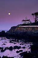 Full moon setting at dawn over Battery Point Lighthouse, Crescent City, Del Norte County, California