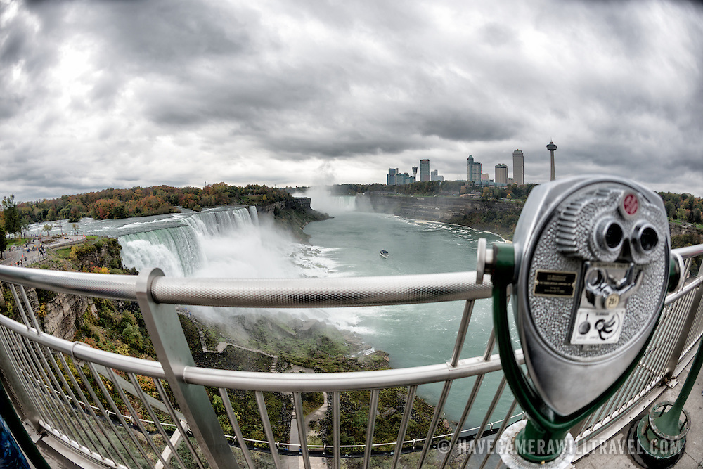 A viewing telescope at Niagara Falls on the Niagara River on the border between the United States and Canada.