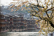 Photograph of a row of lots of ancient Chinese stilt houses on the riverfront, Fenghuang, Hunan Province, China