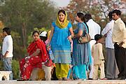 India, Uttar Pradesh, Agra, The Taj Mahal Local woman in traditional sari