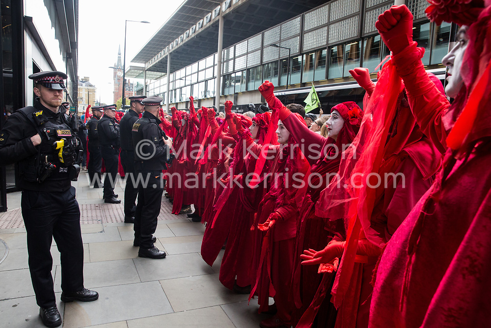 London, UK. 16 October, 2019. Extinction Rebellion's Red Rebel Brigade joins the International Rebellion Autumn Uprising 'No Social Media in a Dead Society' protest outside the headquarters of YouTube against the US video-sharing company's role in 'enabling the spread of systematic disinformation on climate change and the ecological crisis'.
