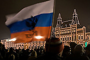 Moscow, Russia, 31/12/2005..Russians celebrate the lengthy New Year and Orthodox Christmas holidays.People gather on Red Square on New Year's eve with Russian flags and the illuminated GUM department store.