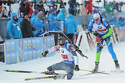 February 8, 2019 - Calgary, Alberta, Canada - Doherty Sean (USA) falls (on the left) as Maksim Varabey (BLR) leaves the stadium after the first shooting during Men's Relay of 7 BMW IBU World Cup Biathlon 2018-2019. Canmore, Canada, 08.02.2019 (Credit Image: © Russian Look via ZUMA Wire)
