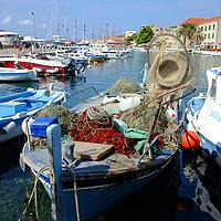 Fishing nets on fishing boat in Bol harbour;<br />Bol, Brac, Croatia.