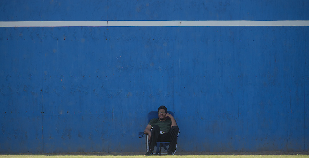 Fullerton, CA - A fan waits for the start of the Orange Empire Conference men's soccer match between Fullerton  College and Golden West College on Novembet 4th, 2016. Golden West won the game, 2-0.