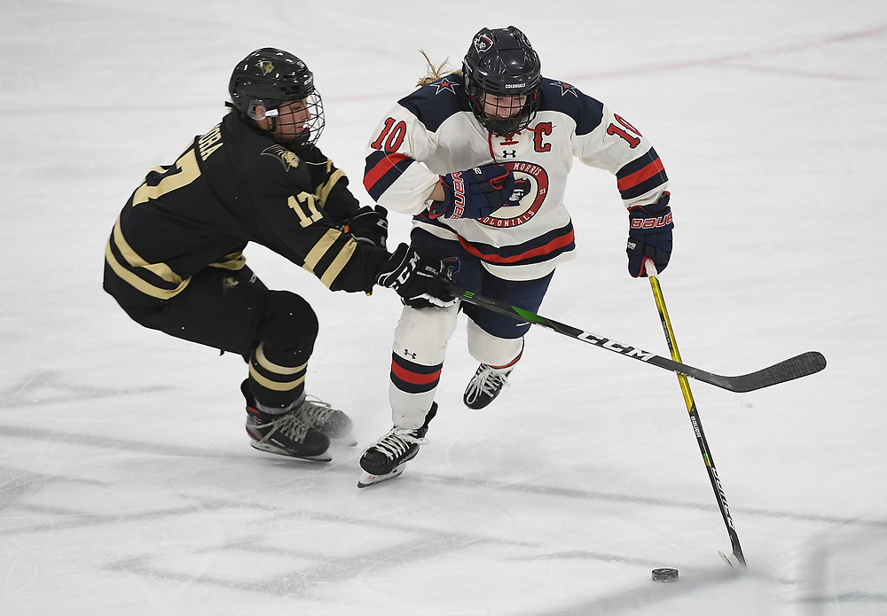 PITTSBURGH, PA - DECEMBER 03: Lexi Templeman #10 of Robert Morris Colonials skates with the puck as Gigi Pora #17 of Lindenwood Lions defends in the third period during the game at Clearview Arena on December 3, 2020 in Pittsburgh, Pennsylvania. (Photo by Justin Berl/Robert Morris Athletics)