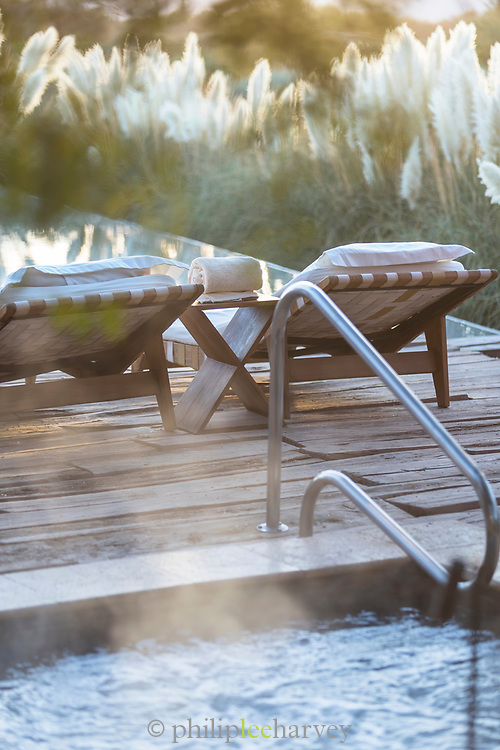 Swimming pool and lounge chairs at Tierra Atacama Hotel, San Pedro de Atacama, Chile