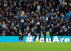 Tottenham Hotspur players cut dejected figures as they concede the 6th goal - Photo mandatory by-line: Dougie Allward/JMP - Tel: Mobile: 07966 386802 24/11/2013 - SPORT - Football - Manchester - Etihad Stadium - Manchester City v Tottenham Hotspur - Barclays Premier League