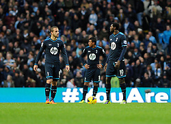 Tottenham Hotspur players cut dejected figures as they concede the 6th goal - Photo mandatory by-line: Dougie Allward/JMP - Tel: Mobile: 07966 386802 24/11/2013 - SPORT - Football - Manchester - Etihad Stadium - Manchester City v Tottenham Hotspur - Barclays Premier League