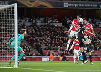 Football - 2019 / 2020 UEFA Europa League - Group F: Arsenal vs. Eintracht Frankfurt<br /> <br /> Pierre-Emerick Aubameyang (Arsenal FC) rises with Joe Willock (Arsenal FC) to head towards goal  at The Emirates.<br /> <br /> COLORSPORT/DANIEL BEARHAM