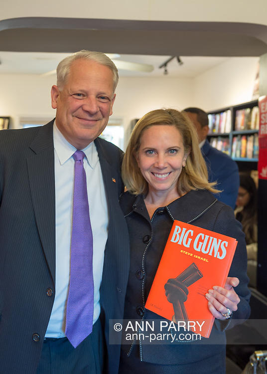 Rockville Centre, New York, USA. April 201, 2018. L-R, Rep. STEVE ISRAEL and Hempstead Town Supervisor LAURA GILLEN pose for photo at special event for Nassau County debut of the former Congressman's (NY - Dem) newest novel BIG GUNS - a satire of the strong gun lobby, weak Congress, and a small Long Island town. The talk and book signing was held at Turn of the Corkscrew Books & Wine store.