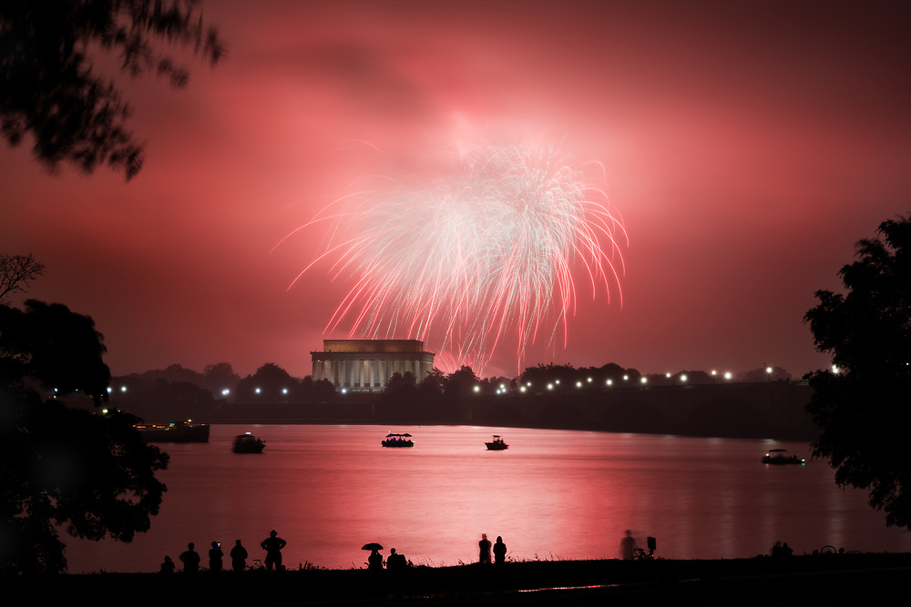 People line the Potomac River to watch the annual fireworks display over the national mall on July 4th, 2016. While low clouds obscured a large portion of the display, those close to their launch point still enjoyed quite a show.