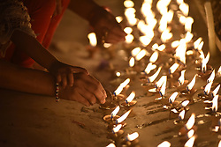 April 25, 2018 - Kathmandu, NE, Nepal - A Little girl along with her mother offering butter lamps in the memory of Earthquake victims during third anniversary in Kathmandu, Nepal on Wednesday, April 25, 2018. Most of the centuries-old monuments and houses were completely or partially destroyed in the catastrophic 7.8 magnitude earthquake that killed over 9,000 people, leaving thousands injured. (Credit Image: © Narayan Maharjan/NurPhoto via ZUMA Press)