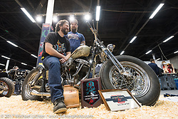 Vlad Romanov of Leecoln Hotrods on his Shovelhead with the awards he just won in the Custom and Tuning Show, the custom bike show portion of the big Motor Spring bike show in Moscow, Russia. Sunday April 23, 2017. Photography ©2017 Michael Lichter.