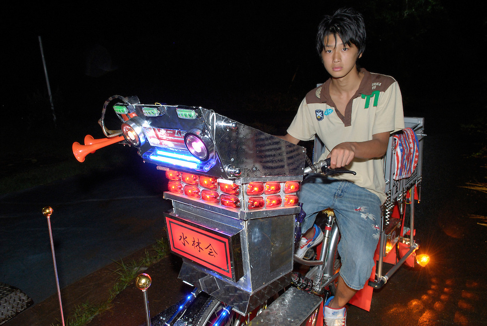 """Yuji Yoshida (14) riding his decochari customized bicycle. """"It's got 50 lights on there now. The battery runs out after about 30 minutes."""""""