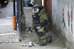 September 20, 2016 - Kathmandu, Nepal - A Nepalese Army bomb disposal personnel poses for a photograph after defusing a pressure cooker bomb at Kanchanjunga School in Dallu, Kathmandu, Nepal on Tuesday, September 20, 2016. Improvised explosive devices were placed in 7 schools as 2 bombs exploded. No human casualties have been reported in the explosions. (Credit Image: © Skanda Gautam via ZUMA Wire)