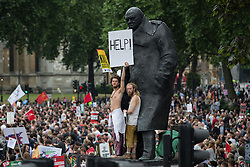 © Licensed to London News Pictures . 20/06/2015 . London , UK . Crowd in Parliament Square underneath Churchull statue . Tens of thousands of people march from the Bank of England to Parliament , to protest economic austerity in Britain . Photo credit: Joel Goodman/LNP