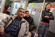 """People in the unemployment office of Nou Barris district waiting to be attended while the office is ocupied by strikers. // Spain's Marchs for Dignity has organized an ocupation of the unemployment offices –INEM- on the eve of May 1st International Worker's Day. With the motto """"bread, work, roof and dignity"""", a total of 400 unemployment offices has been occupied by different movements during two hours (11h to 13h) in the Spanish State. 6 millions of people are unemployed in Spain, many of them don't get the public assistance from the adminitration and others receive the minimum amount of 426€ at a month. 30th April."""
