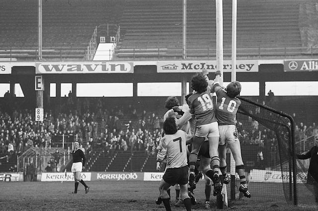 A bunch of players all jump near the goalpost as the ball edges close to the Dublin cross bar during the All Ireland Senior Gaelic Football Semi Final, Dublin v Kerry in Croke Park on the 23rd of January 1977. Dublin 3-12 Kerry 1-13.