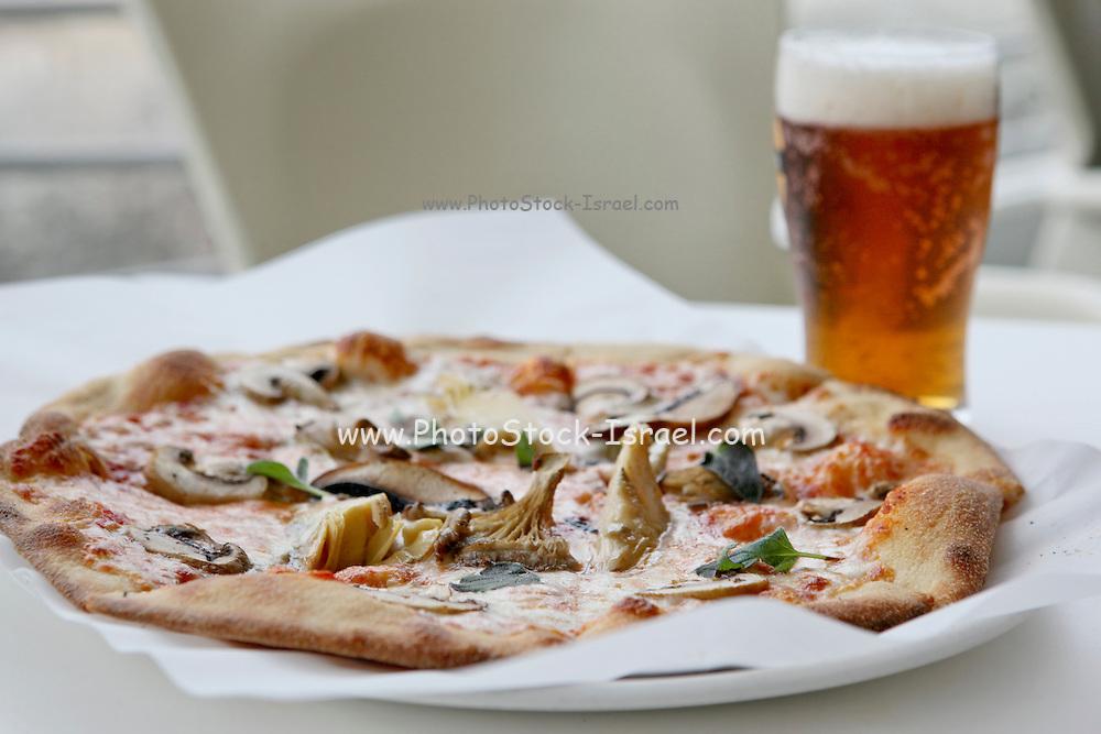 Freshly baked mushroom pizza served with beer