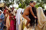 """""""Lost Daughters: Sex Selection in India"""" <br /> <br /> The social perception that females are """"worth"""" less than males, and the extremes to which families go to have boys and get rid of girls. Through her images Mary shows us the difficulties that women face in India, even before birth, such as fetal sex selection, government-financed abortion of female fetuses and abandonment after birth. But her work doesn't stop there; she follows women through their life cycle and shows the consequences of this sexist ideology.<br /> <br /> Women are an endangered species in India. 'Raising a daughter,' said an old Punjabi saying, 'is like watering your neighbor's garden.' In the last 20 years India has lost about 10 million girls to sex selection. Due to the devaluation of women and expensive dowries required by the groom's family, women are holding out for boy children. Sons are preferred in India because boys will be more prosperous and take care of their aging parents. They carry on the family name and are the ones to inherit family wealth. Girls are seen as a drain on family resources. Many women rely on illegal ultrasounds to determine sex, leading to the aborting of girl fetuses. The long-term effects are coming to fruition. Despite its status as one of the world's largest democracies, India is a country where women suffer a low status. <br /> <br /> Photo shows: - The daughter of a trafficked woman sits on an older girl's shoulder in a village in Mewat.<br /> ©Mary F. Calvert/Exclusivepix media"""