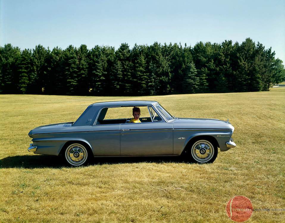 A 1964 Studebaker Daytona Hardtop is shown in this factory promotional shot.