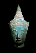 Large head of a Buddha dressed. 15th Century, 16th Century bronze sculpture from Ayutthaya, Thailand