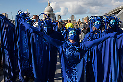 The blue rebels cross the Millennium Bridge with fellow climate activists from the Ocean Rebellion and Extinction Rebellion during a colourful Marine Extinction March on 6 September 2020 in London, United Kingdom. The activists, who are attending a series of September Rebellion protests around the UK, are demanding environmental protections for the oceans and calling for an end to global governmental inaction to save the seas.