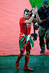 CARDIFF, WALES - Tuesday, October 13, 2015: Wales' Gareth Bale is presented to the supporters after qualifying for the finals following a 2-0 victory over Andorra during the UEFA Euro 2016 qualifying Group B match at the Cardiff City Stadium. (Pic by Paul Currie/Propaganda)