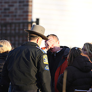 Unidentified people, believed to be parents and relatives, leaving the fire station in Sandy hook after today's shootings at Sandy Hook Elementary School, Newtown, Connecticut, USA. 14th December 2012. Photo Tim Clayton
