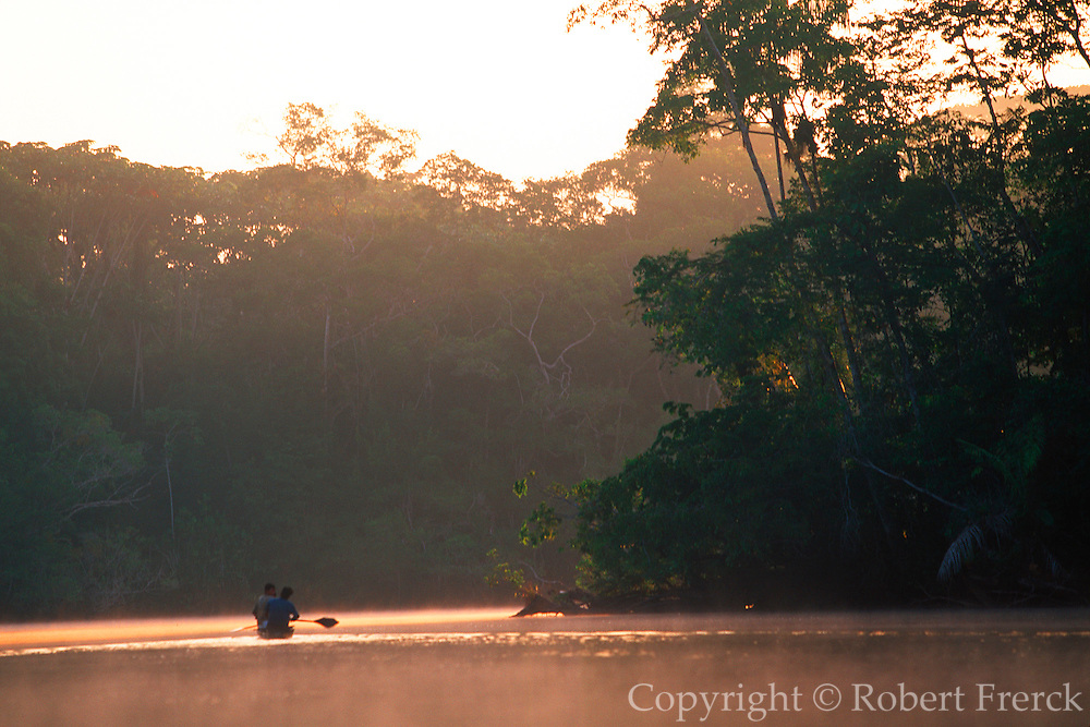 ECUADOR, AMAZON BASIN Napo River; indian in a dugout canoe