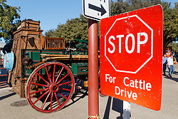 Stop for Cattle Drive sign and chuck wagon, Fort Worth Stockyards, Fort Worth Texas, USA.