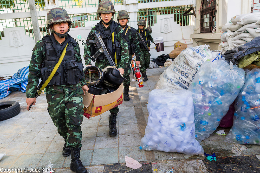 23 MAY 2014 - BANGKOK, THAILAND: Thai soldiers recover illegal weapons and body armor hidden near the anti-government PDRC protest area. The Thai military seized power in a coup Thursday evening. They suspended the constitution and ended civilian rule. This is the 2nd coup in Thailand since 2006 and at least the 12th since 1932. The army has ordered both anti-government protestors in Bangkok and pro-government protestors in the suburbs to go home and arrested leaders of both groups.    PHOTO BY JACK KURTZ