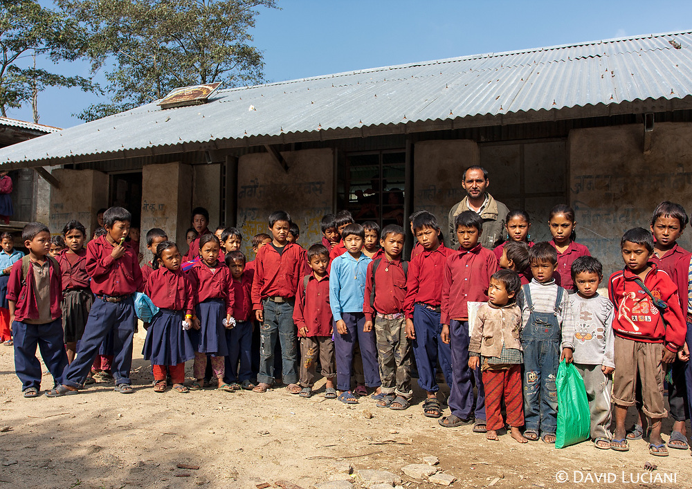 Teacher and students posing in front of their school in Pati Bhanjyang.